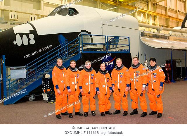 The STS-123 crewmembers take a break from a training session to pose for a photo in the Space Vehicle Mockup Facility at the Johnson Space Center