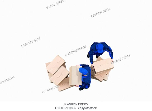 Elevated View Of Two Professional Movers Moving The Cardboard Boxes Against White Background