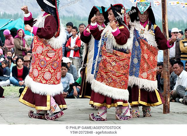 Dancers at the Hunder Camel Festival in the Nubra Valley of Ladakh, a Tibetan Buddhist region of northern India
