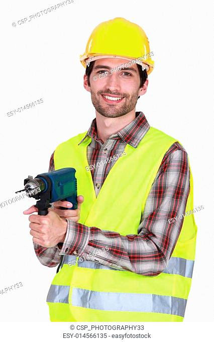 Construction worker with a power drill