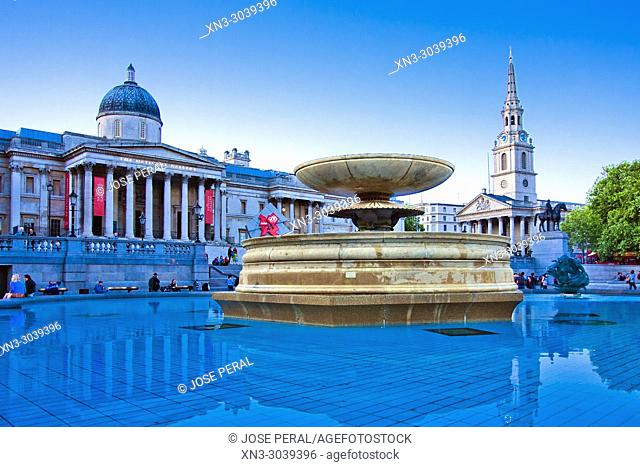At left National Gallery, Trafalgar Square, City of Westminster, London, England, UK, United Kingdom, Europe