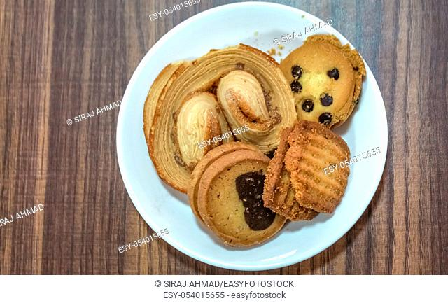 Cookies placed in a plate at a business meeting