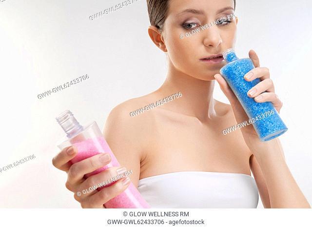 Woman smelling bath crystals