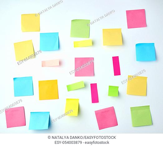 multicolored blank paper stickers of different sizes and shapes on a white background