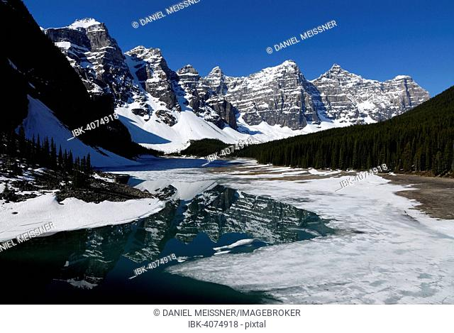 Wenkchemna Peaks mountain group reflected in the glacial Moraine Lake, Valley Of The Ten Peaks, Banff National Park, Rocky Mountains, Alberta Province, Canada