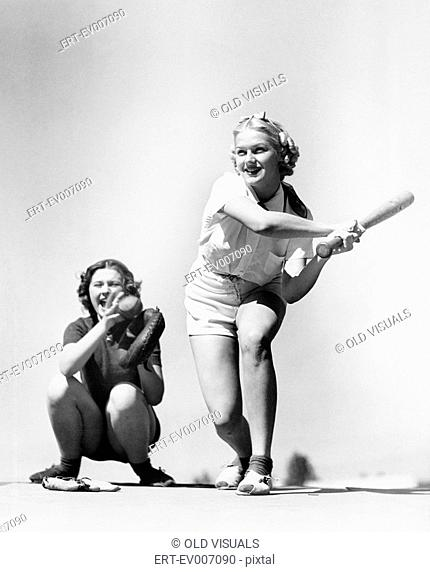 Two women playing baseball All persons depicted are not longer living and no estate exists Supplier warranties that there will be no model release issues