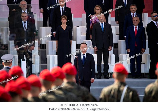 01 September 2019, Poland, Warschau: Polish President Andrzej Duda (M) stands before soldiers at the central commemorations of the Republic of Poland on the...