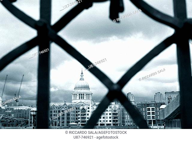 Wrought Iron Gate of Shakespeare's Globe Theatre, Saint Pauls Cathedral in the background,  Bankside, Southwark, London, England