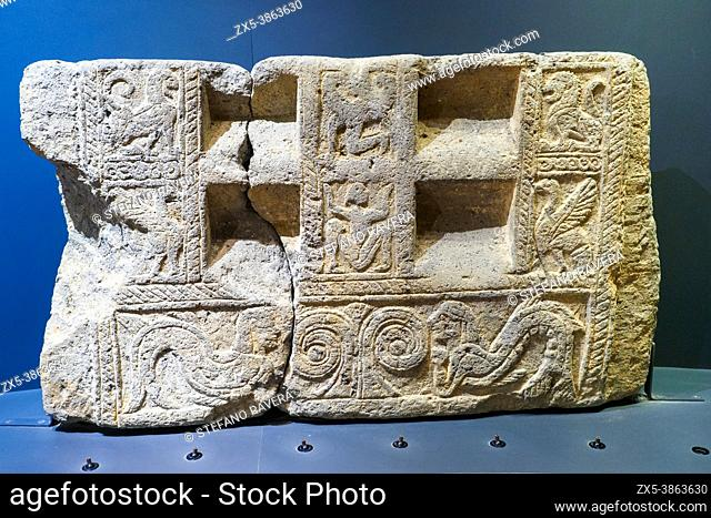Staircase slab - Nenfro (volcanic rock). Metope decoration: top left: a lion - bottom left: bird with spread wings - top center: winged demon - bottom center:...