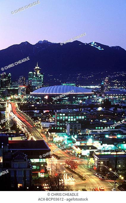 Downtown at dusk with mountains beyond, Vancouver, British Columbia, Canada