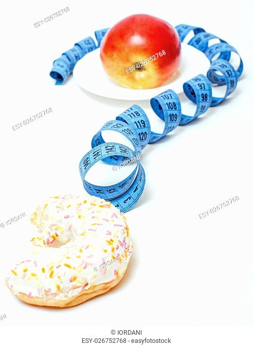 new diet concept, question sign in shape of measurment tape between red apple and donut isolated on white, candy vs fruit