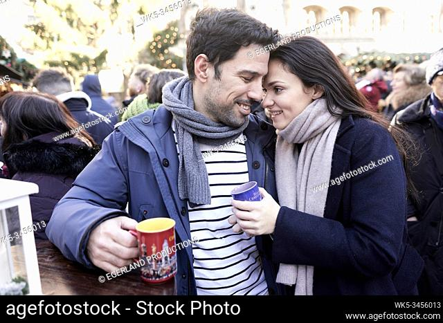 couple with Glühwein at christmas market in Munich, Germany