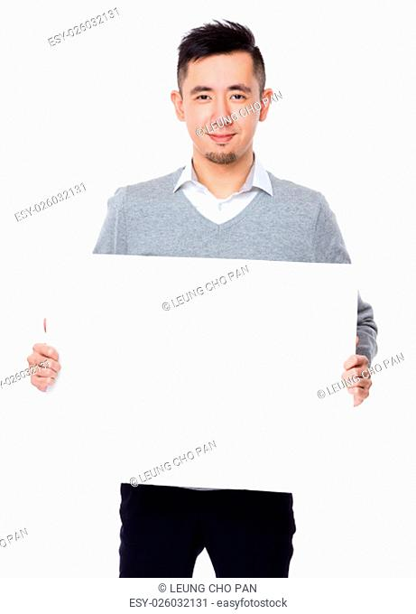 Businessman showing the white banner