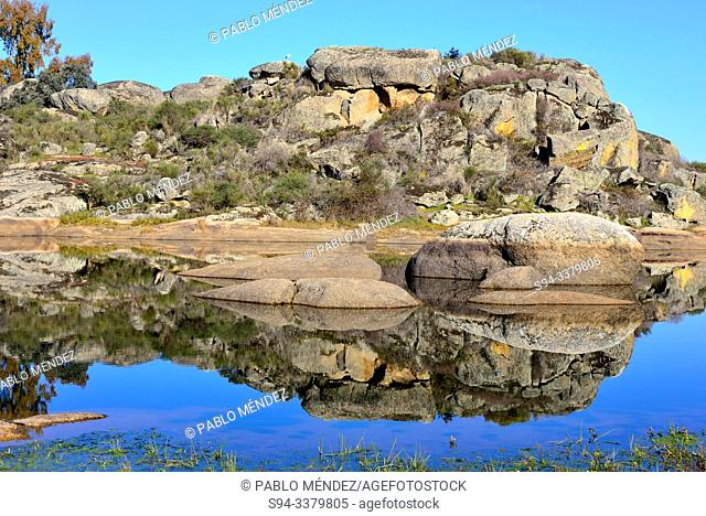 Reflection in a lake of Los Barruecos, Caceres, Spain