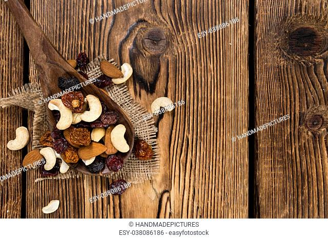 Wooden table with Trail Mix (selective focus, close-up shot)