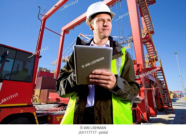 Worker With Digital Tablet Loading Of Containers At Port