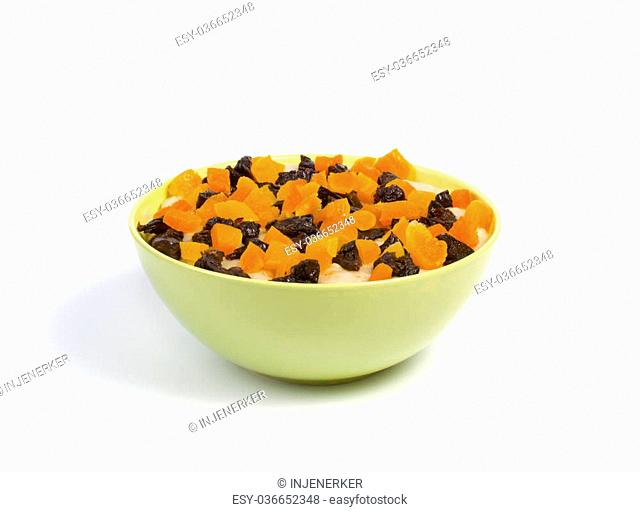 Oatmeal with dried fruit in a bowl isolated on white background