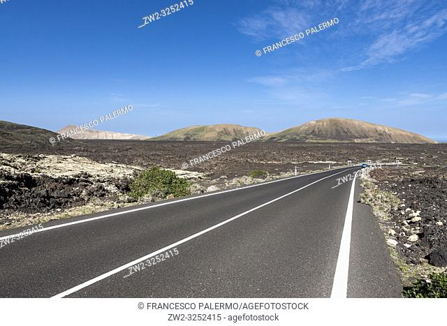 The road between the volcanic lava. La Geria, Lanzarote. Spain