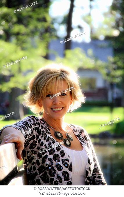 A woman sitting outdoors in Spokane, Washington