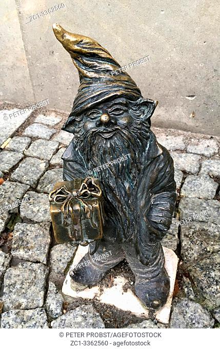 Small bronze statue Wroclaw dwarfs in the streets of the Polish city Wroclaw - Poland