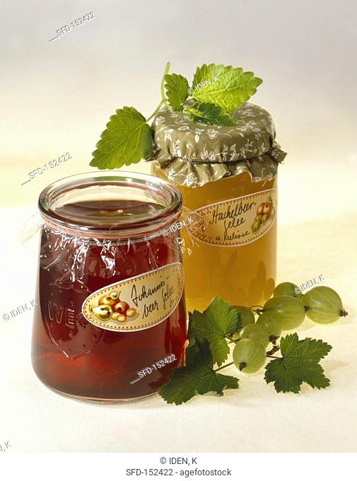 Gooseberry jelly and redcurrant jelly in jam jars