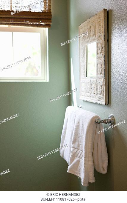 Close-up of a white towel on rail in the bathroom at home