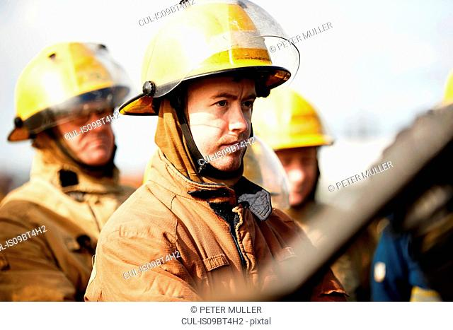 Firemen training, small group of firemen listening to instructions