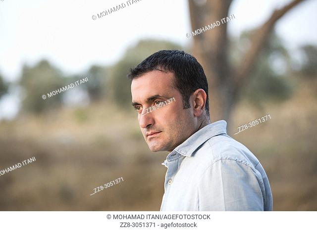 Middle Eastern man looking away outdoors