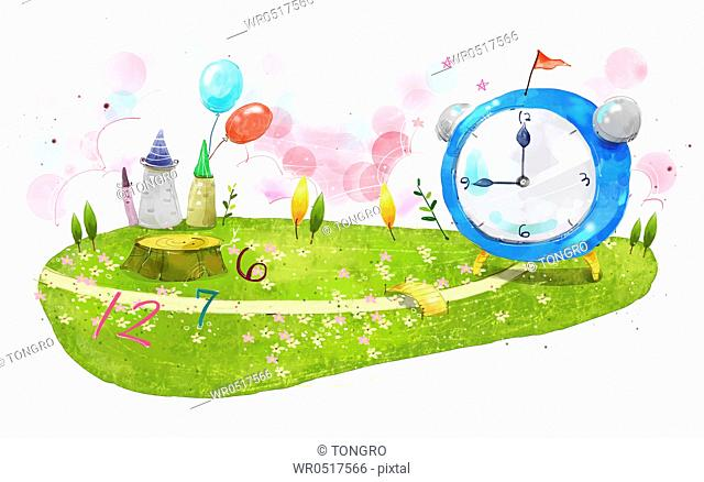 The big clock and numbers on the grass field