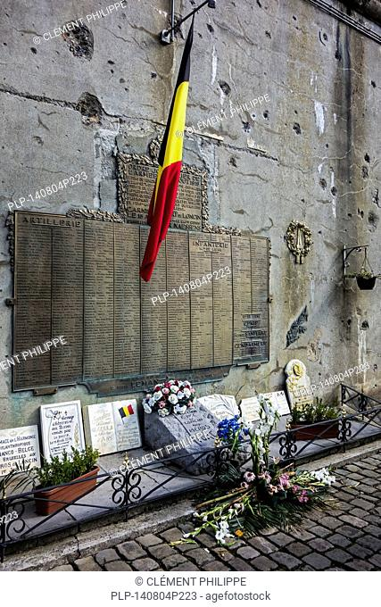Commemorative plaque on bullet-scarred wall in the Fort de Loncin, one of twelve forts built as part of the Fortifications of Liège