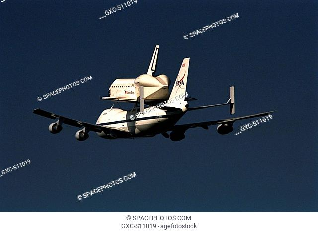 11/11/1997 -- The orbiter Atlantis, riding atop the modified Boeing 747 Shuttle Carrier Aircraft, departed Kennedy Space Center KSC on Nov