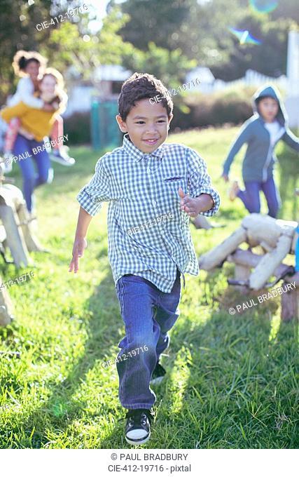 Boy walking in grass outdoors