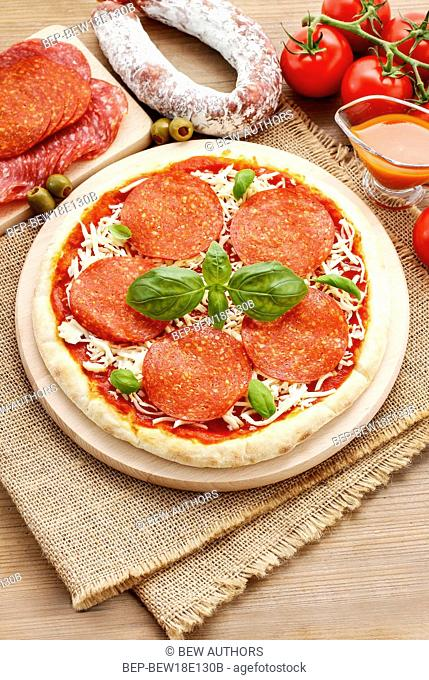 Italian cuisine: pizza with salami. Traditional dish