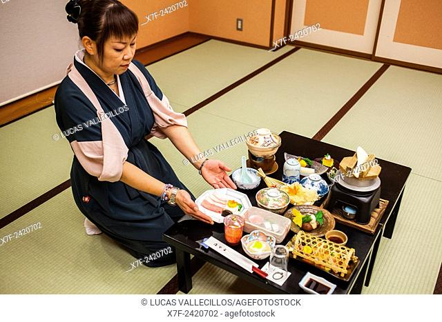 Waitress serving traditional food, Fujiya Ryokan accommodation, Kawayu Onsen, Kumano Kodo, Nakahechi route, Wakayama, Kinki, Japan