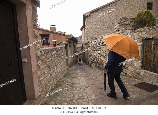 Man with orange umbrella in Albarracin is one of the most beautiful villages in Teruel Aragon Spain
