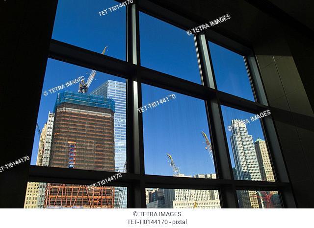 USA, New York, New York City, Construction site of World Trade Center through window