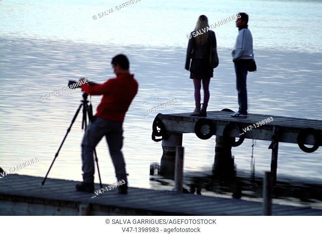 Photographer in lake, Natural Park L'Albufera, Dehesa del Saler, marsh, El Saler, Valencia, Spain