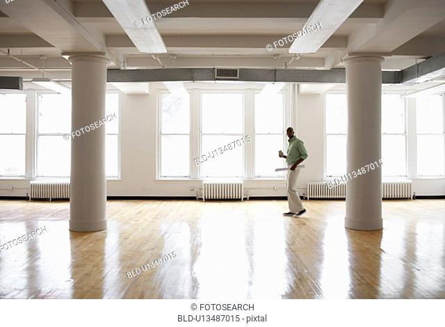Male architect in empty room