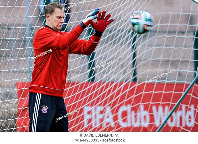 """FCBayern Munich's goalkeeper Manuel Neuer takes part in a training session at the stadium""""""""Stade Adrar"""""""" in Agadir, Morocco, 20December 2013"""