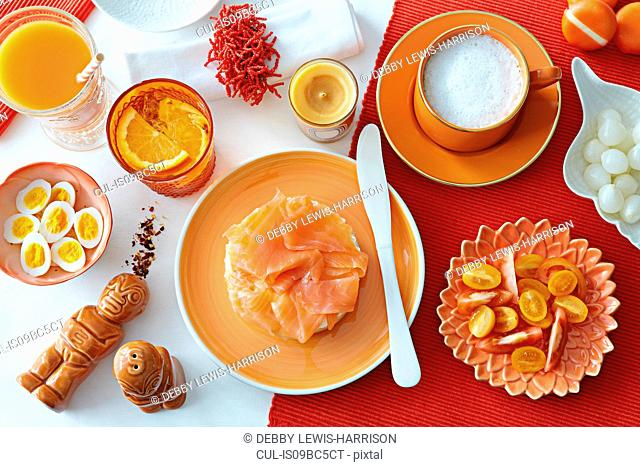 Table with fresh salmon, boiled eggs and tomatoes