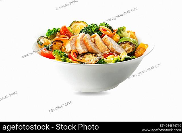 Healthy chicken meal with grilled chicken and vegetables isolated on white background. Healthy lunch bowl