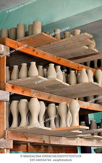 Rows of Drying Pottery in workshop