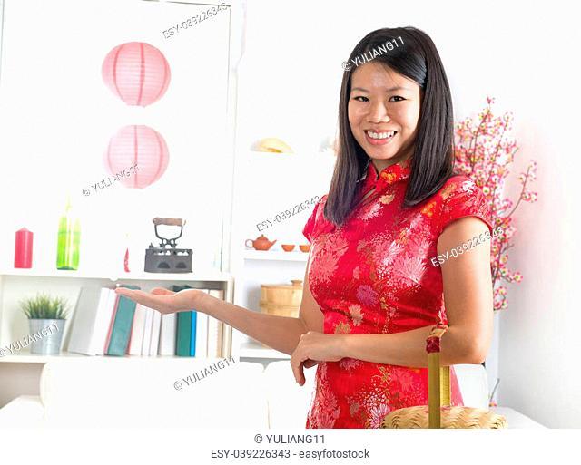 asian female celebrating chinese new year