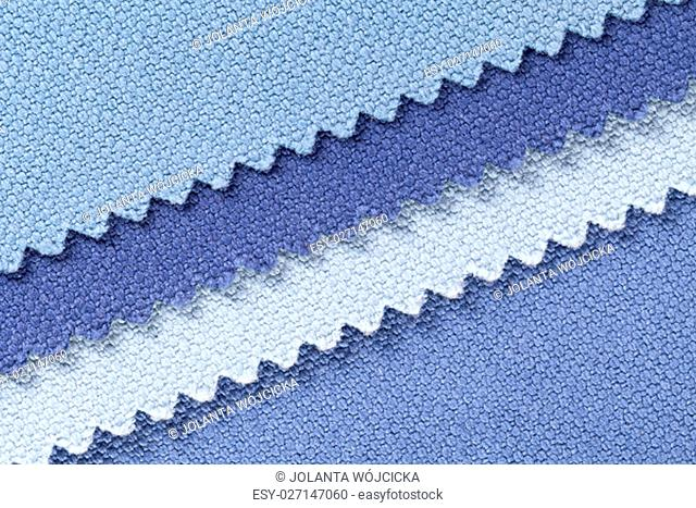 Composition of colored diagonal stripes of serrated cotton fabric, place for text