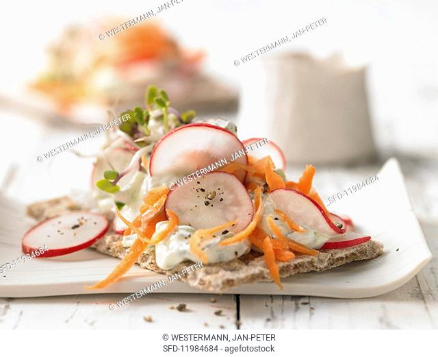 A crispbread with cucumber quark and radish