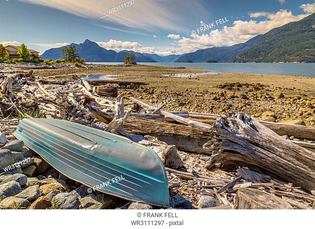 How Sound and overturned boat at Furry Creek off The Sea to Sky Highway near Squamish, British Columbia, Canada, North America