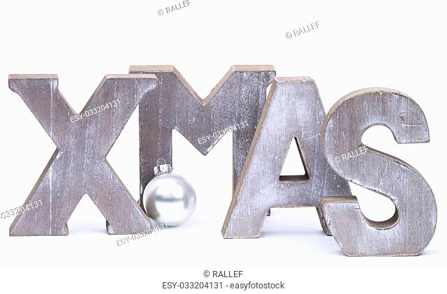 Capital letters forming the word xmas with silver christmas ball over white