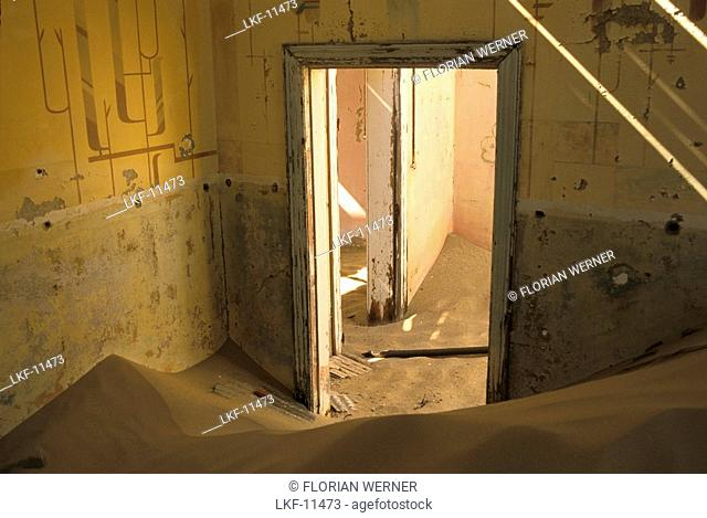 Abandoned house full of sand, Former mining village, now a ghost town, Kolmanskop, Namibia, Africa