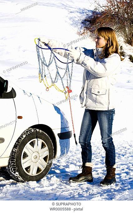 Woman car snow chains
