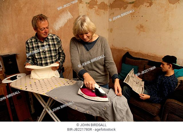 Teenager with grandparents and ironing